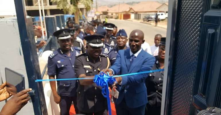 DCOP Frederick Adu Anim being assisted by Francis Kwesi Nyankson to commission the four-bedroom apartment for personnel of ACP Police Station