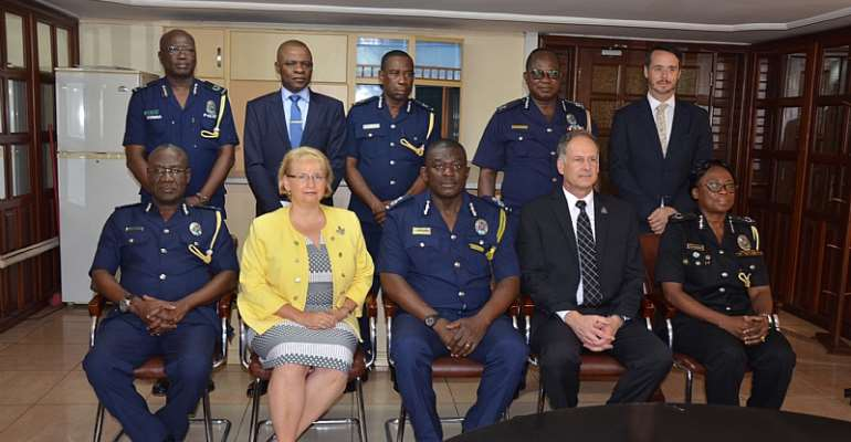 The Acting IGP in group photographs with his Canadian guests
