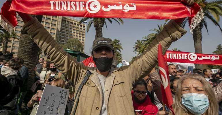 Tunisian demonstrators gather during a protest in Tunis, Tunisia on February 06, 2021.  - Source: Photo by Yassine Gaidi/Anadolu Agency via Getty Images