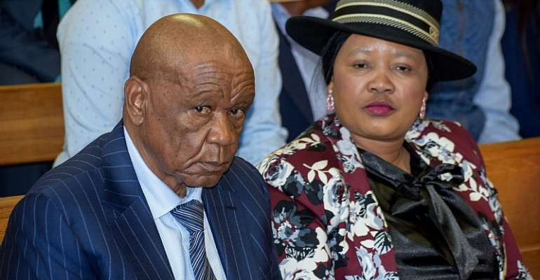 Lesotho Prime Minister Tom Thabane and his new wife, Maesiah, at the Magistrate Court in Maseru.  - Source: AFP-Getty Images/Molise Molise