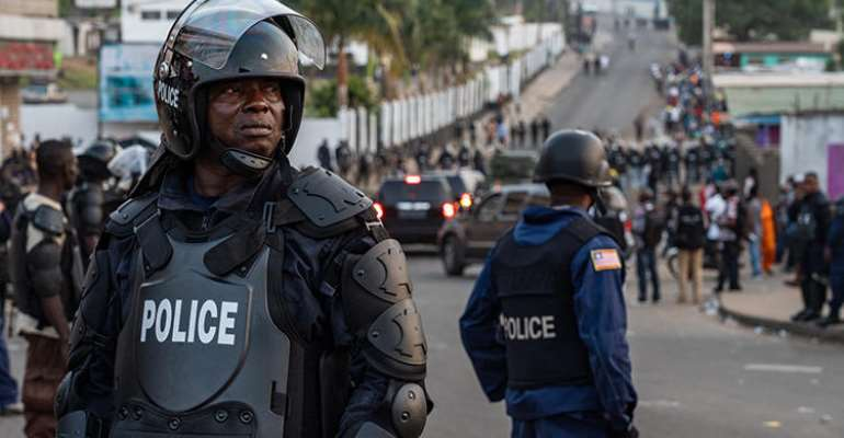 Police are seen in Monrovia, Liberia, on January 6, 2020. Police recently arrested journalist Kaluba Akoi over his Facebook posts. (AFP/Carielle Doe)