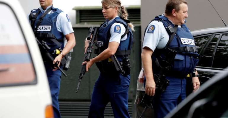 Armed police patrol outside a mosque in central Christchurch, New Zealand, Friday, March 15, 2019.
