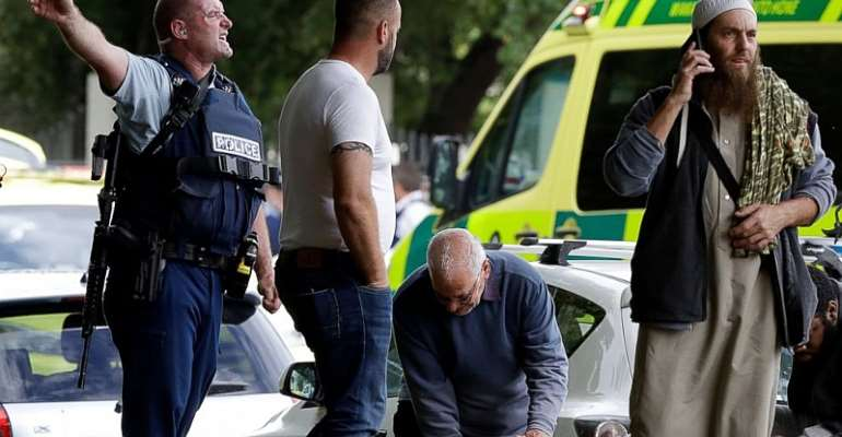 Police attempt to clear people from outside a mosque in central Christchurch, New Zealand