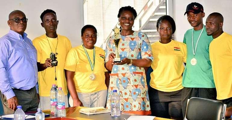 Wheelchair Tennis Team Presents Trophy To GTF