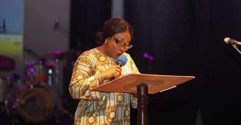 Madam Ayorkor speaking at the event