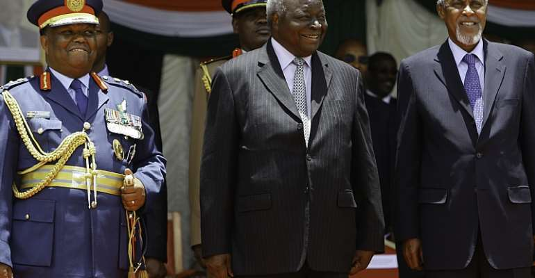 Mohamed Yusuf Hajj (right) with former President Mwai Kibaki (centre), and former Chief of Defence Forces General Julius Waweru Karangi (left) during a farewell ceremony for Kibaki in 2013.   - Source: EPA/Daniel Irungu
