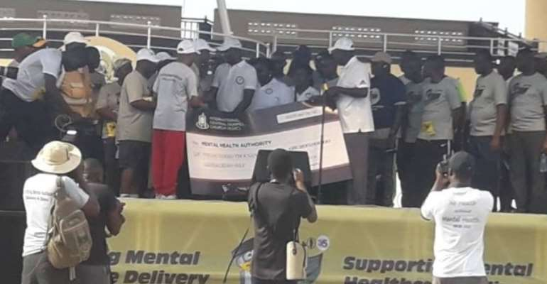 General Overseer of ICGC presenting the cheque to Dr. Akwesi Osei of MHA