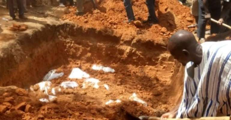 Passengers who were burnt beyond recognition buried in a mass grave