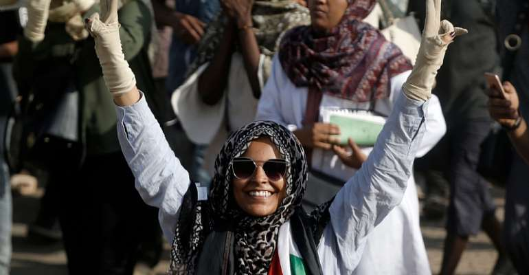 A woman flashes the V for victory sign as Sudanese protesters demonstrate in Khartoum on July 25, 2019. - Source: Ashraf Shazly/AFP via Getty Images