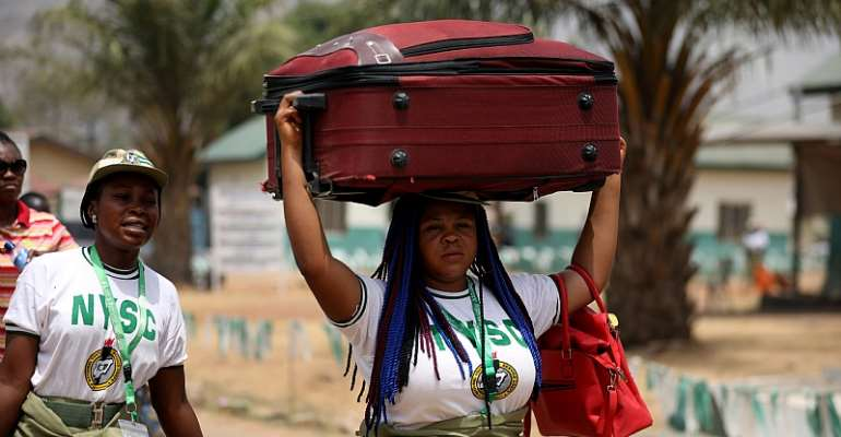 A National Youth Service Corps member leaves the orientation camp in Kubwa, Abuja, following an order by the Nigerian government to curb the spread of the COVID-19.  - Source: Kola Sulaimon/AFP via Getty Images