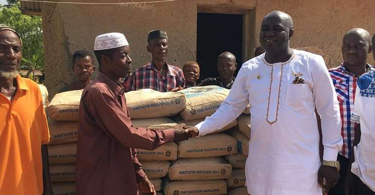 Asene Manso DCE Supports Tabita JHS With 100 Bags Of Cement