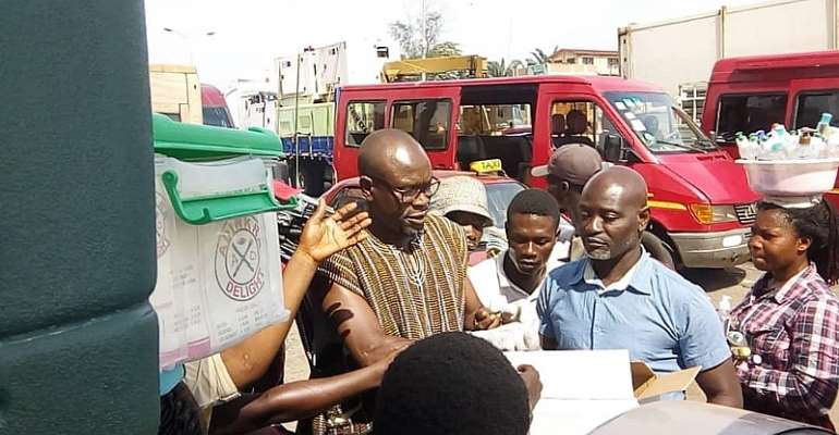 COVID-19: Black Stars Head Coach CK Akonnor Share Hand Sanitizers To Hawkers In Accra