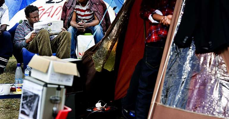 Iraqi, Iranian and Somali asylum seekers at a tent camp in the Netherlands - Source: ROBIN UTRECHT/AFP/GettyImages