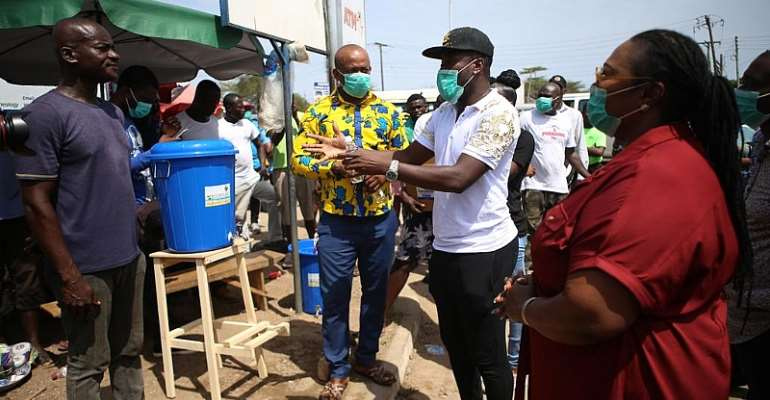 Covid-19: Gyan Donates Sanitizers To Residents Of Weija-Gbawe Constituency