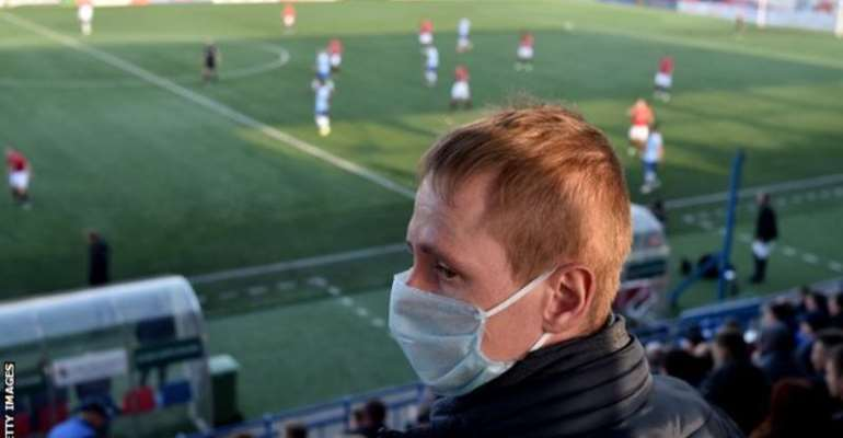 An FC Minsk fan watches his team play on Saturday