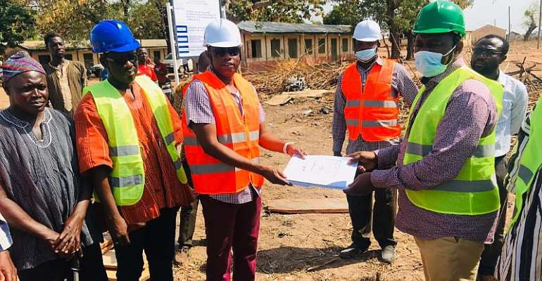 The NDA officials with the contractor at the project site