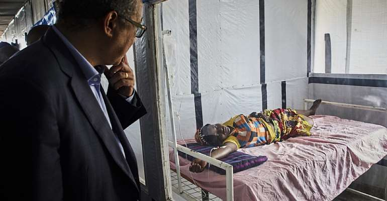 WHO Director-General Tedros Adhanom greets an Ebola patient at a treatment center in North Kivu, DRC.  - Source: Hugh Kinsella Cunningham/EPA-EFE