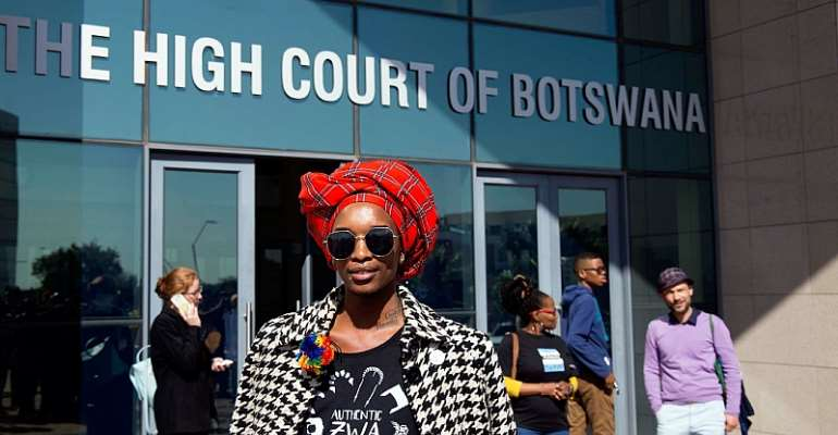 An activist poses for the camera outside Botswana High Court which ruled in favour of decriminalising homosexuality in June 2019. - Source: Tshekiso Tebalo/AFP via Getty Images