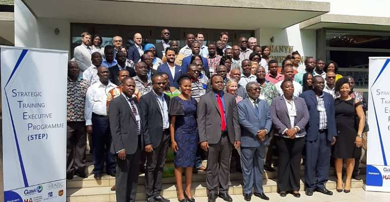 Participants and officials in a group photograph