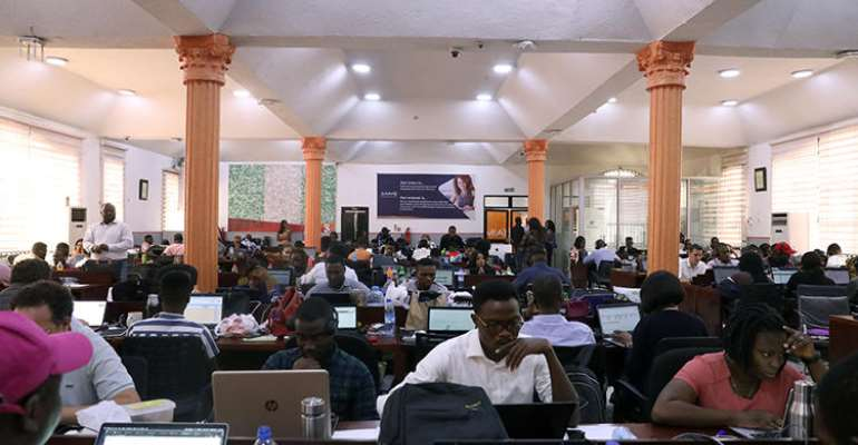 People use computers in Lagos, Nigeria, on January 20, 2020. Nigerian journalists recently spoke with CPJ about their concerns over a proposed social media bill. (Reuters/Temilade Adelaja)
