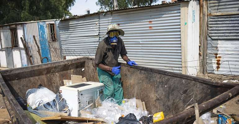 An unemployed man in Diepsloot, Johannesburg, collects trash for resale before South Africa went into a Covid-19 lockdown.  - Source: EFE-EPA/Kim Ludbrook