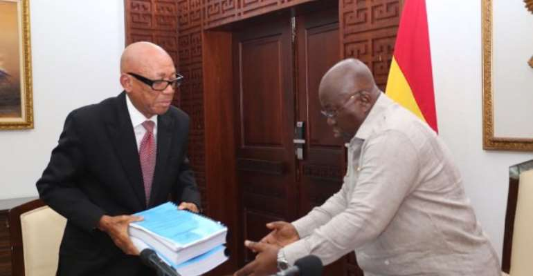 Emile Short chair of a three-member Commission of Inquiry[L] presents report to the President, Nana Akufo-Addo, [R]
