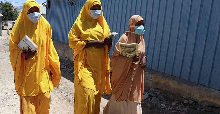 Somali women on a coronavirus awareness campaign - Source: Abdirazak Hussein/GettyImages