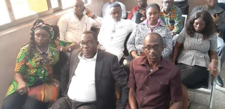 NDC Executives accompanied Ofosu Ampofo [middle] to the CID headquarters where he was granted¢400,000 bailwith two sureties.