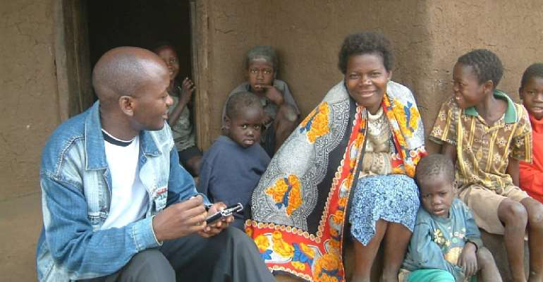 Dr Edward Mitole visiting a child-headed household in Chiradzulu, Malawi, in 2004.