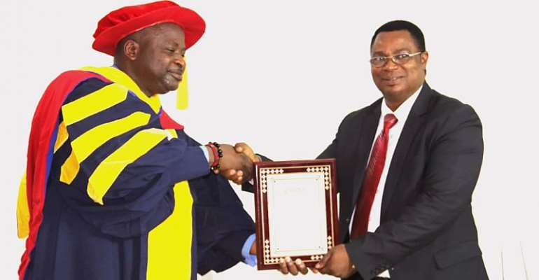 Rev Kweitsu (R) Receiving The Citation From Dr. Richard Eghan, A COGAI Executive