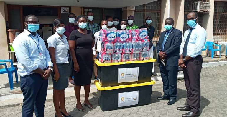 Officials Of Mamprobi Polyclinic With Specialist Doctor In Charge Of The Mamprobi Polyclinic, Dr. Charlotte-Alberta Baaba Cato (Third Left) Receiving The Package