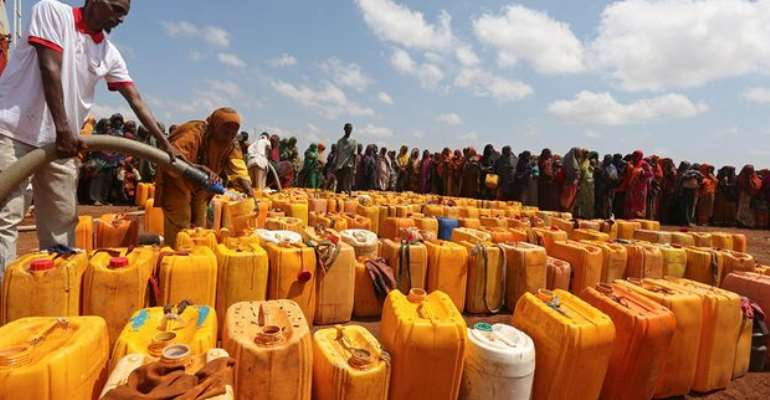 Internally displaced Somali women gather with their jerrycans to receive water Photograph: Feisal Omar/Reuters