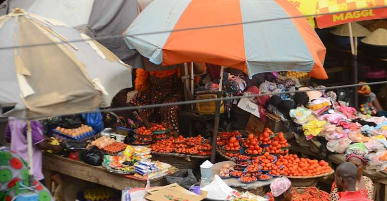 A food market in Ibafo in Nigeria's Ogun State. The effects of COVID-19 on food systems will be keenly felt in poorer countries.   - Source: Photo by Olukayode Jaiyeola/NurPhoto via Getty Images