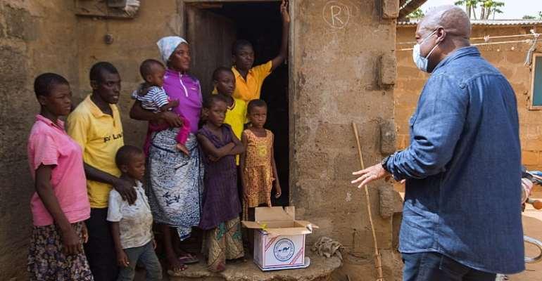 COVID-19: Mahama Presents Food Items To Households In Koluedor, Borteiman