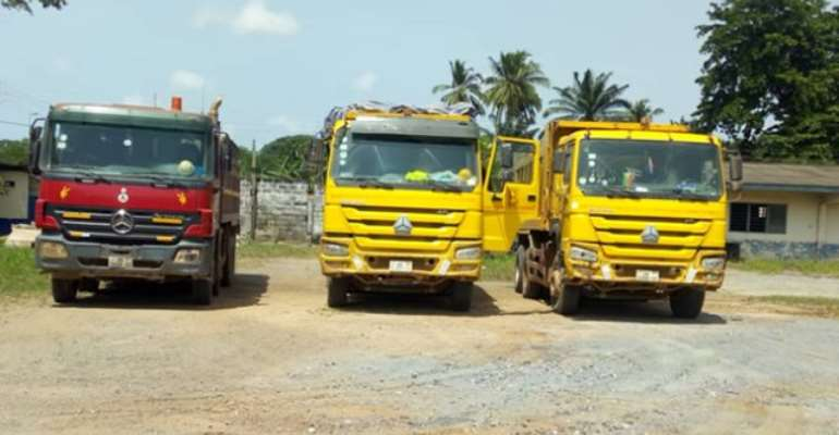 Some of the seized trucks
