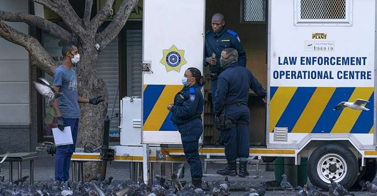 South African Law Enforcement officers check movement papers during the country's 21-day national total lockdown. - Source: Nic Bothma/EPA