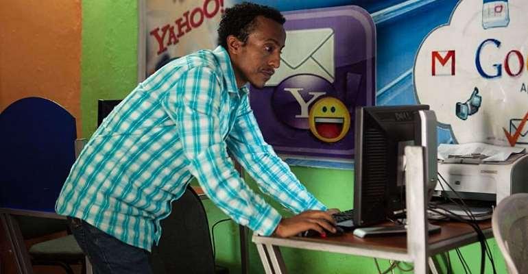 Internet cafe owner Kaleb Alemayehu checks a computer in Adama City, Ethiopia. Internet shutdowns are common. - Source: Solan Kolli/Getty Images