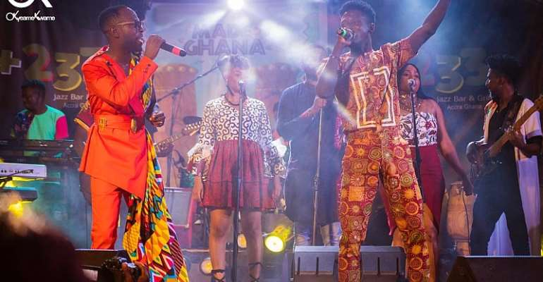 Okyeame Kwame and Kwame Eugene performing on stage at the album launch