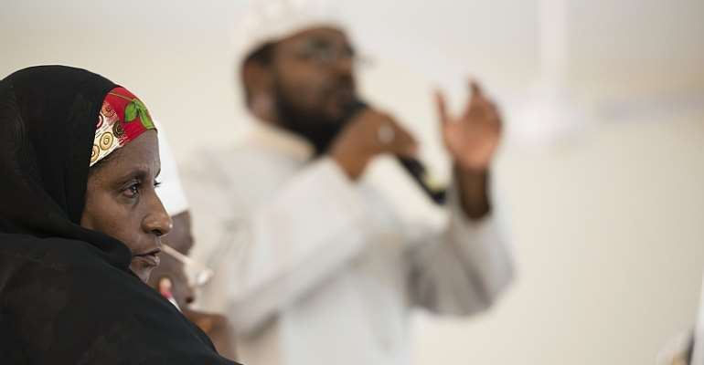 An Imam addresses a Kenyan Muslim Youth Alliance meeting flanked by community leaders.  - Source: (Photo by Neil Thomas/Corbis via Getty Images)