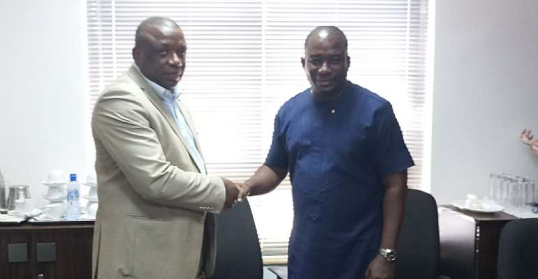 Dagbo Thomas, CEO of Dagbo Limited Inc (left) and Bright Semanu Attah, CEO of Modello Properties Gh Limited (Right) in a handshake
