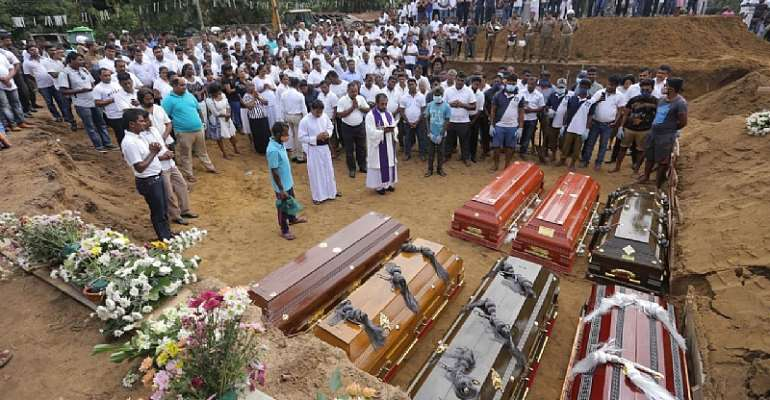 A mass burial on Wednesday for victims of the Easter Sunday bombings in Sri Lanka.