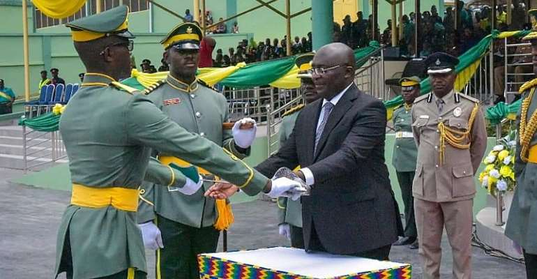 Vice President Dr. Mahamudu Bawumia presenting a prize to one of the officers
