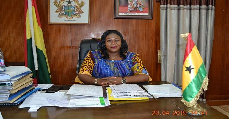Mrs. Evelyn Richardson Bono Regional Minster working in the office