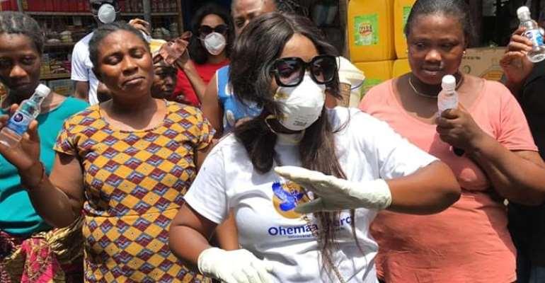 Ohemaa Mercy Distributes Hand Sanitizers To Market Women