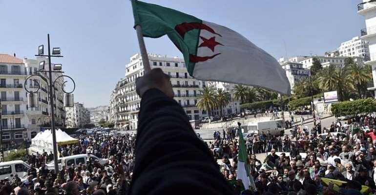 Photo: Ryad Kramdi/AFP