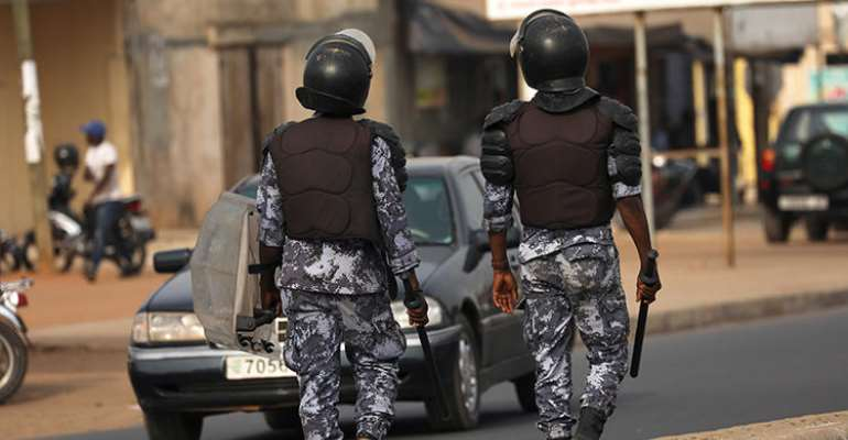 Police officers are seen in Lome, Togo, on February 28, 2020. Togo recently ordered three newspapers to suspend operations. (Reuters/Luc Gnago)