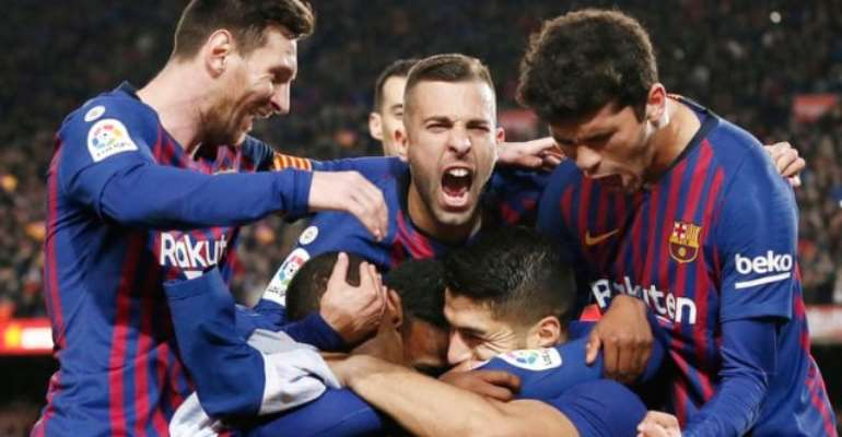 Barcelona's players celebrate Luis Suarez's opening goal against Atletico Madrid. Photograph: Pau Barrena/AFP/Getty Images