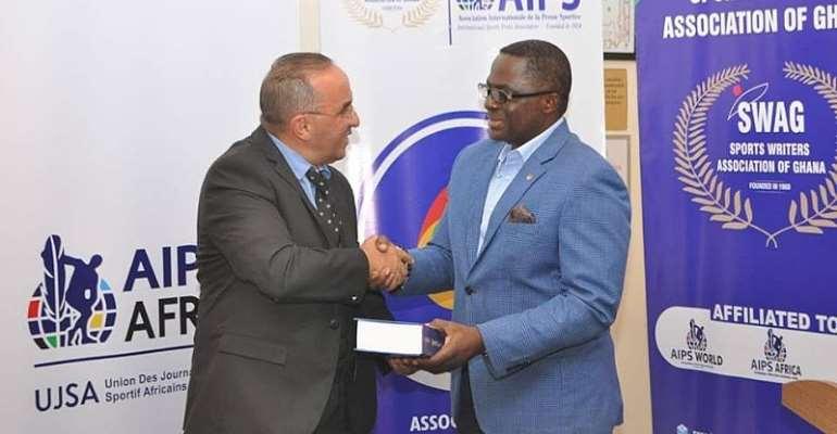 Mr Ben Nunoo Mensah, the President of Ghana Olympic Committee (GOC) [Right]