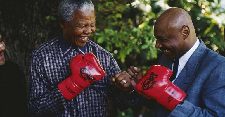 Former South African President Nelson Mandela with former American world boxing champion Marvin Hagler. The undated photo was taken after Mandela's release.  - Source: Louise Gubb/GettyImages
