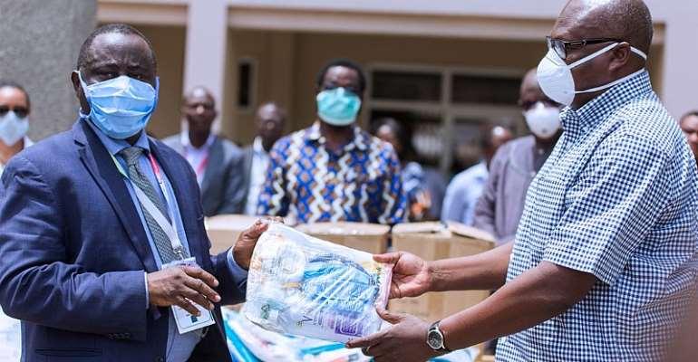 Mahama Donates PPE, Gum Boots To Korle-Bu Hospital